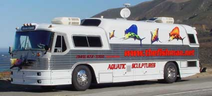 Fiberglass custom-painted hotrod flamed sailfish & Bat Rays on the side of Todd's Aquatic sculpture charter bus